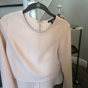 Intermix brand beautiful zip back blouse.
